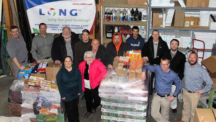 LONG_Anchorage_Team_w_Food_Bank_Donation